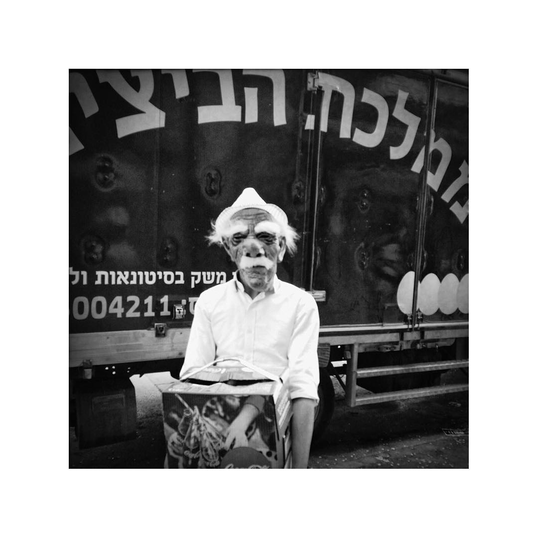 #Purim or not, eggs must be delivered on time. Delivery boy in Orthodox Jerusalem wearing a mask and posing for us in a rarely fashion.