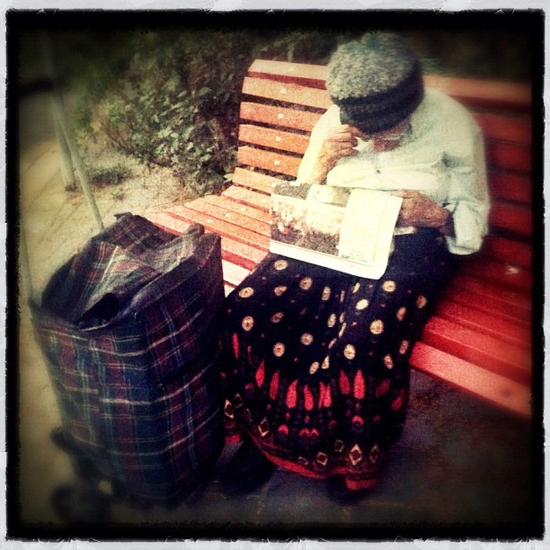 Old woman struggling to read